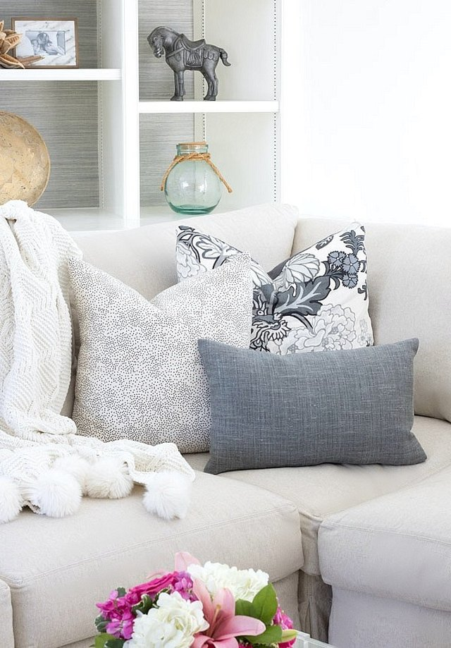 three denim and white throw pillows in varying shapes and sizes