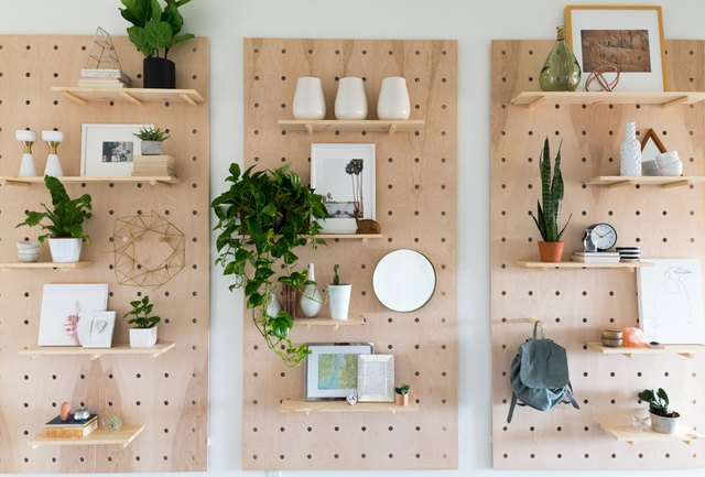pegboard shelves with plants and pictures