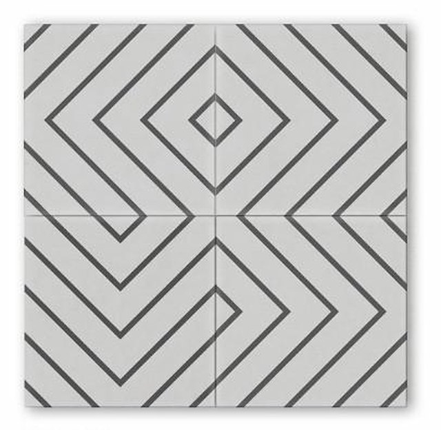 White geometric tile with black lines