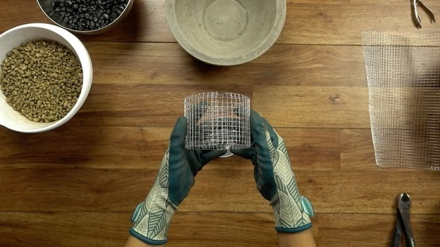 Making a fuel can holder with wire mesh for DIY concrete fire bowl.