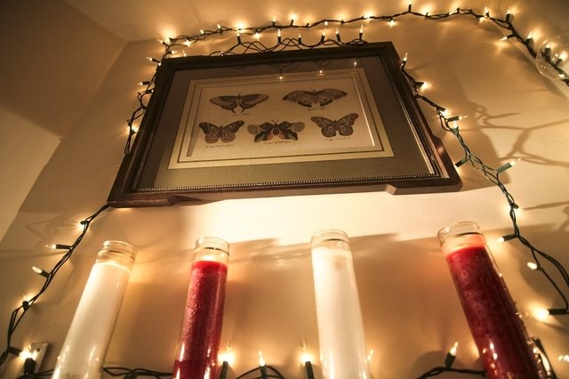Ideas on where to hang christmas lights in a bedroom hunker hang strands of christmas lights from the ceiling use a staple gun to secure the end of a strand of lights to one corner of the bedroom ceiling aloadofball Images