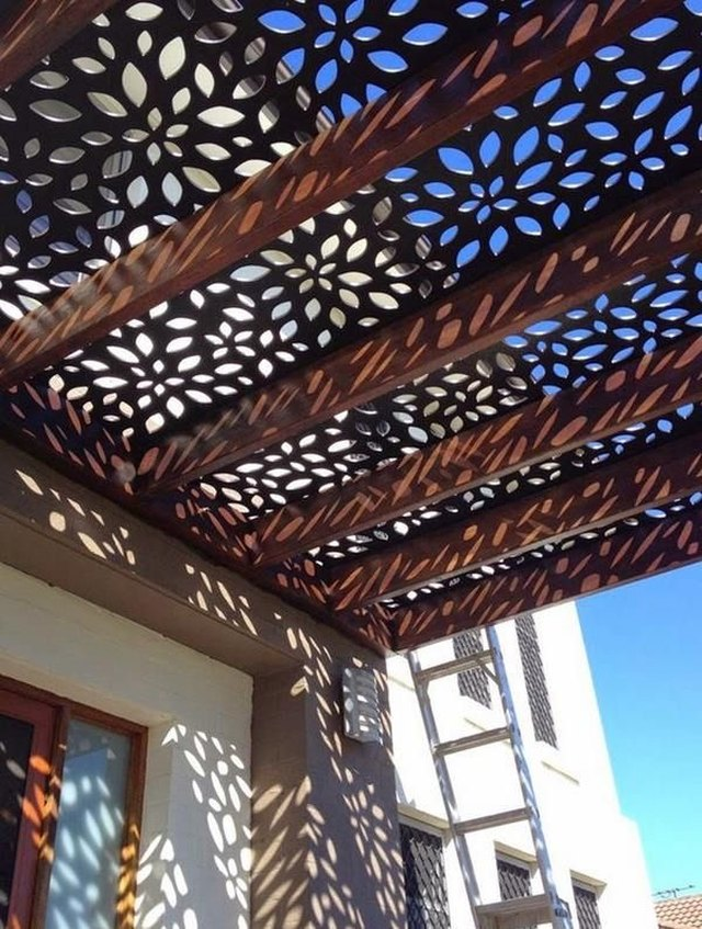 Cut metal shadow screen patio cover