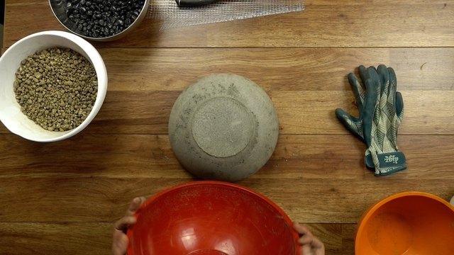 Molding concrete for DIY tabletop concrete fire bowl.