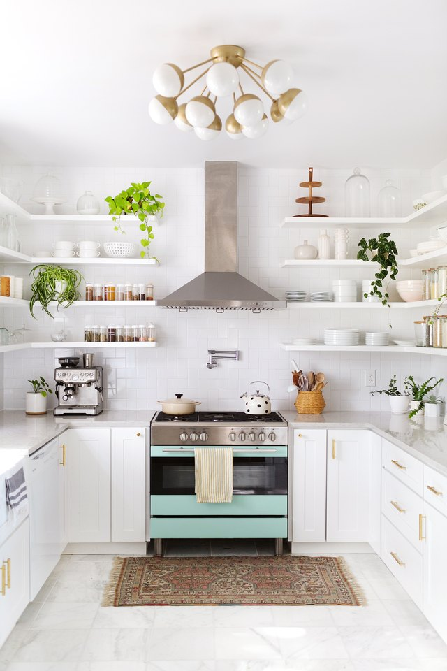 white kitchen with greens