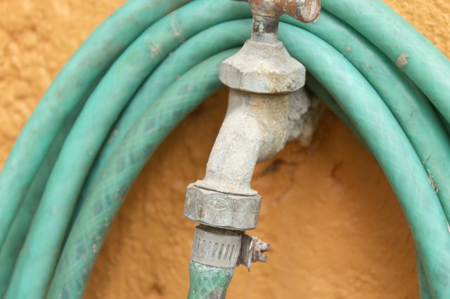 Most often garden hoses become stuck because the hose end fittings get bent or damaged. & How to Remove Stuck Garden Hoses | Hunker