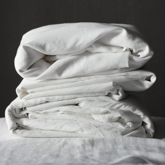 Stack of white folded sheets