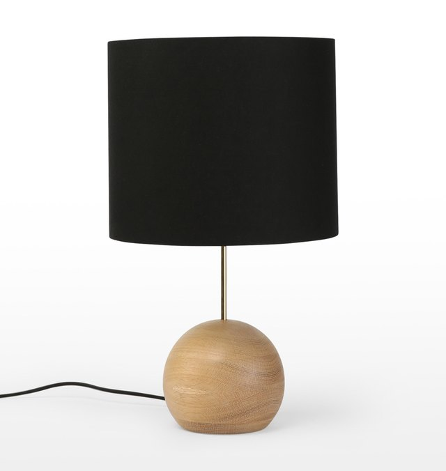 Table lamp with black shade and bulbous wooden b