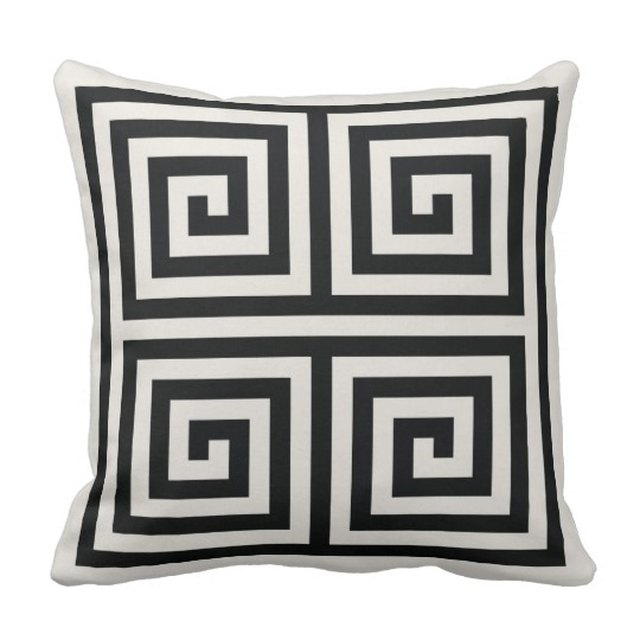 Black and white throw pillow with geometric pattern