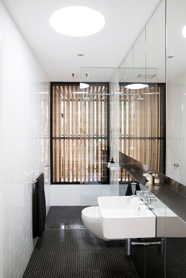 Bathroom with white tiled wall.