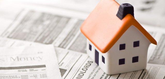 ceramic house landlord in newspaper