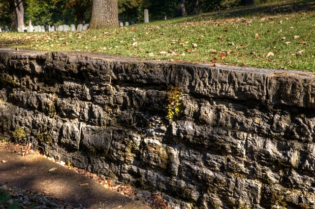 Rough stone in a retaining wall.