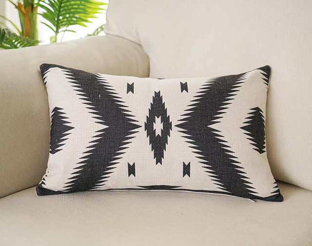 Black and white lumbar pillow with aztec design