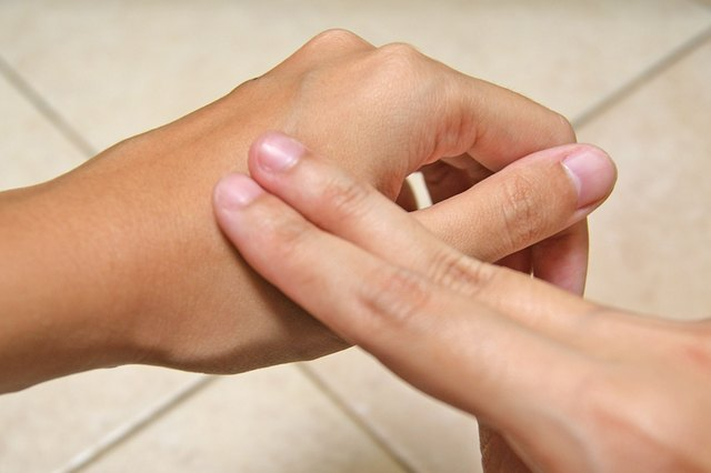 Insect repellent being rubbed on skin.