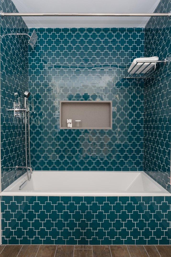 bathtub with teal blue tile