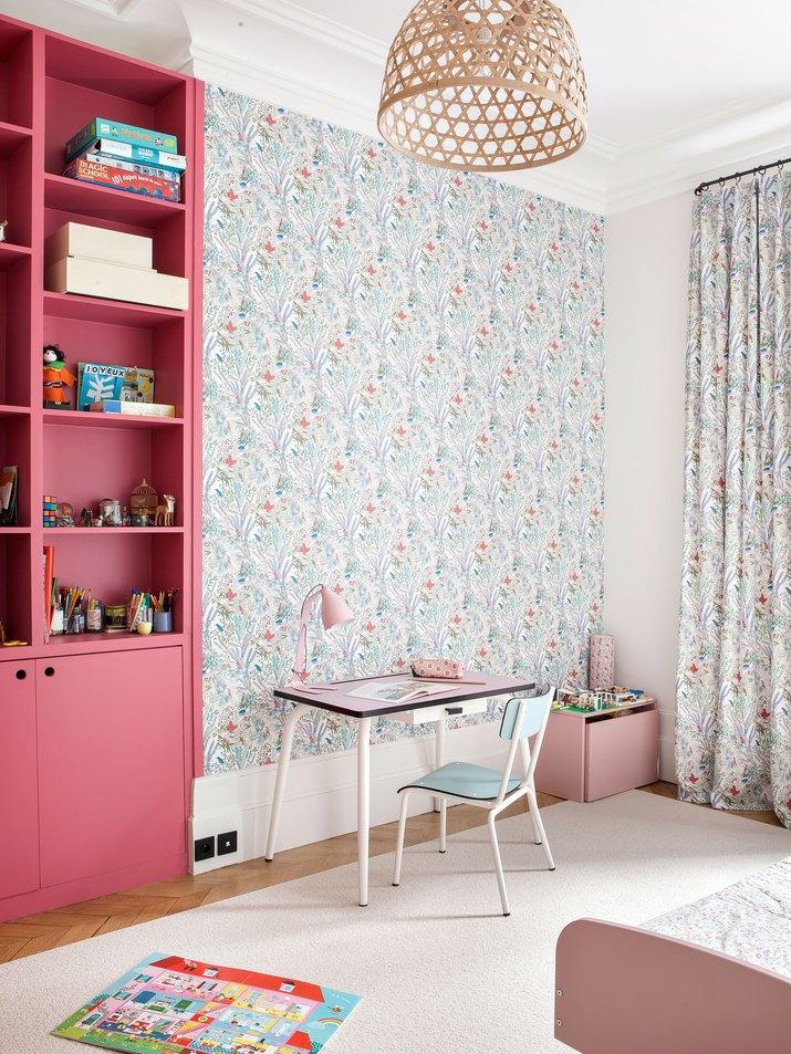 little girl's bedroom with wallpaper