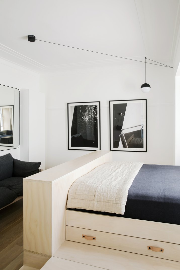 studio apartment with plywood bed platform