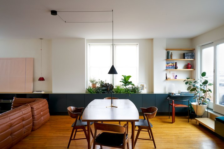 dining room with green cabinets