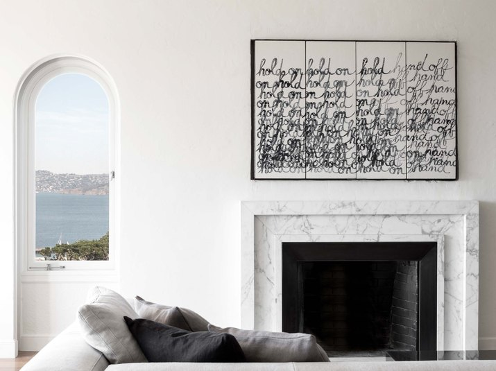 minimalist living room with marble fireplace surround