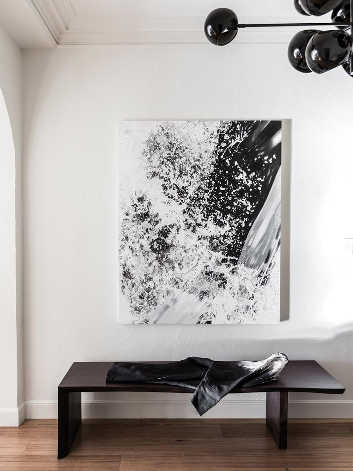 black and white abstract art with black light fixture