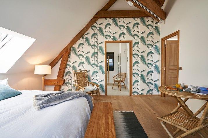 bedroom with green wallpaper