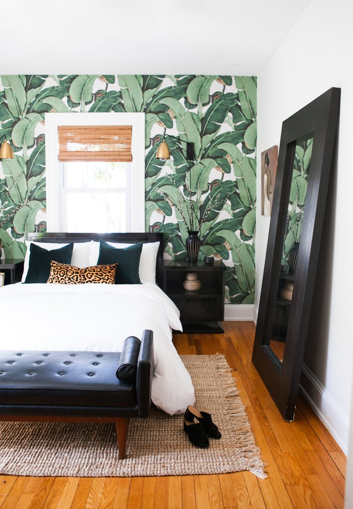 bedroom with palm wallpaper