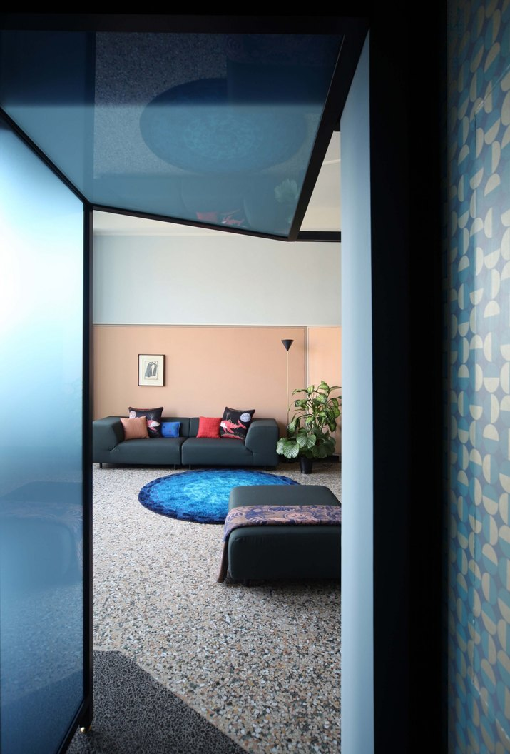 blue and pink living room with terrazzo floors
