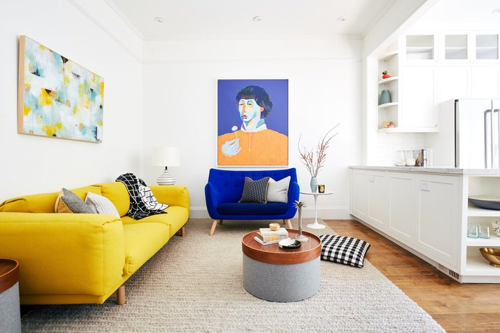 colorful living room with yellow couch