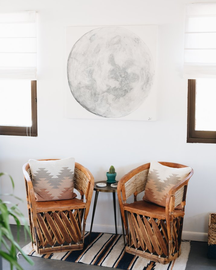 rustic equipale chairs in living room near windows
