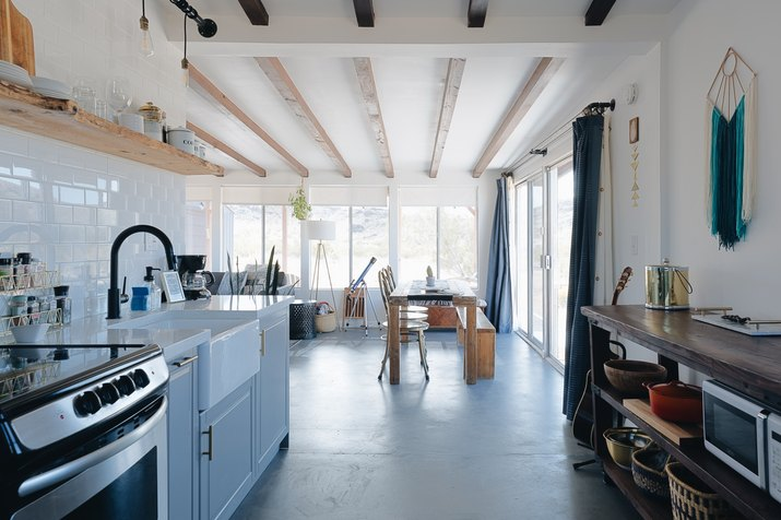 rustic modern cabin kitchen with exposed ceiling beams