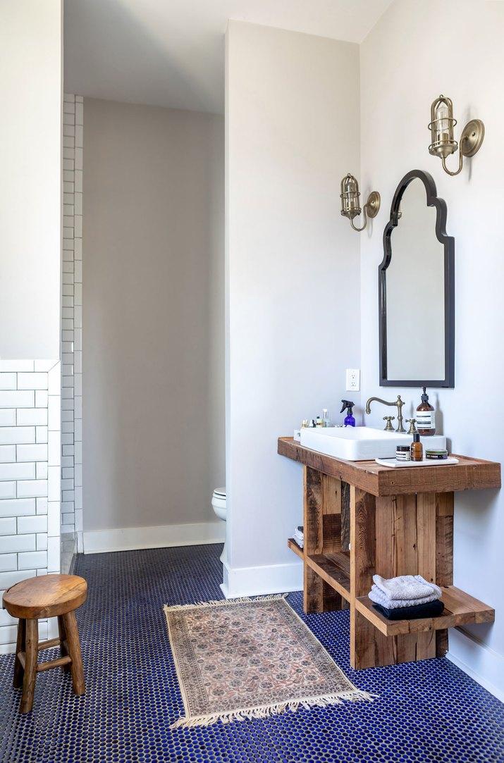 Master bathroom with blue floor tile
