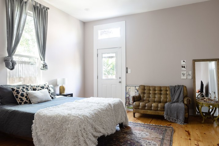 Master Bedroom with gray walls and wood floors