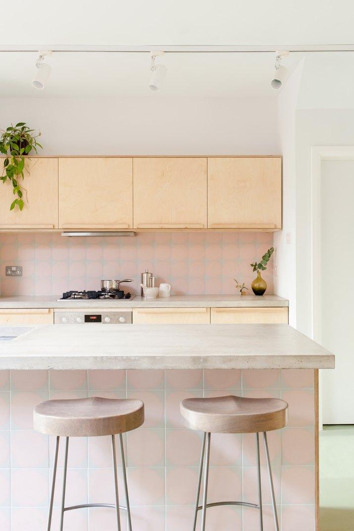 contemporary minimalist kitchen with concrete countertops