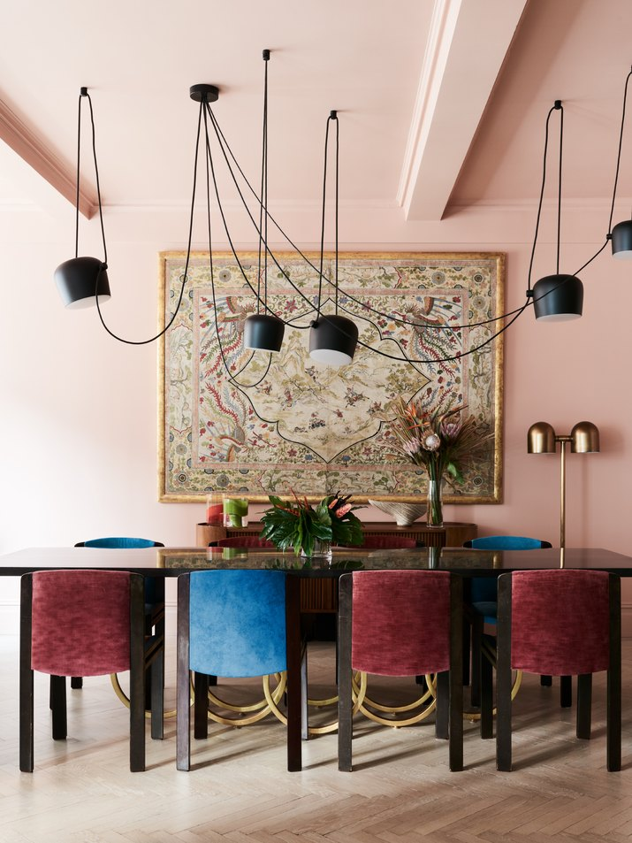 pink dining room with pendant lighting
