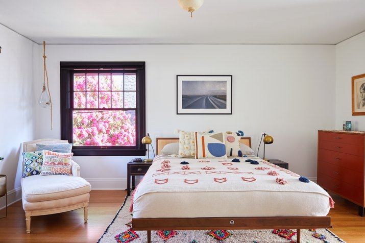 eclectic bedroom with white walls