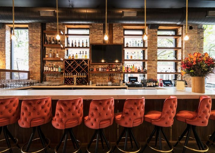 Dramatic bar with red seating