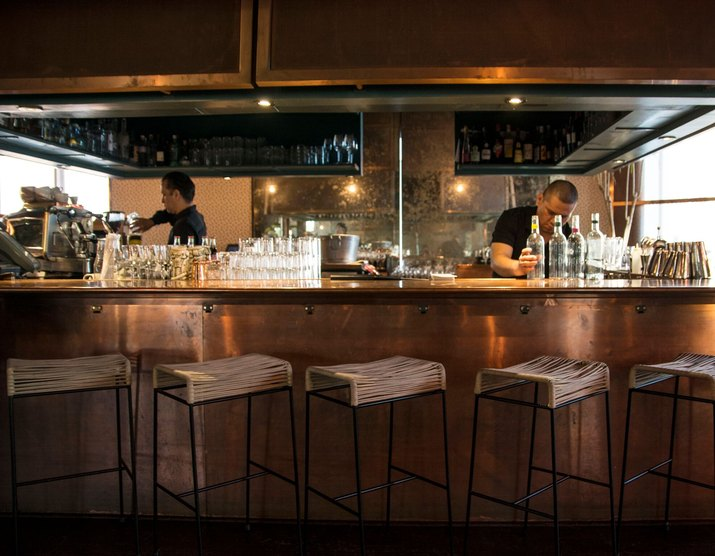 Copper bar with stool seats.