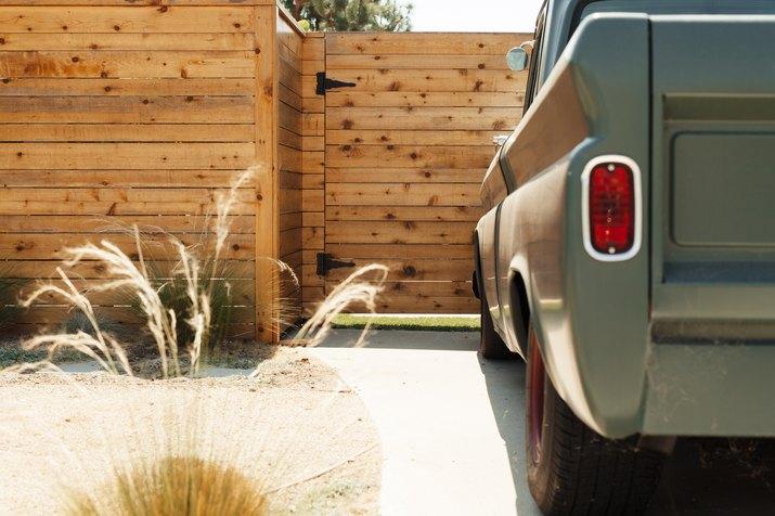 truck outside wood fence