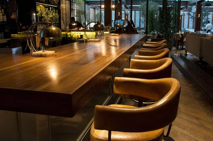 The wooden bar with leather curve backed seating