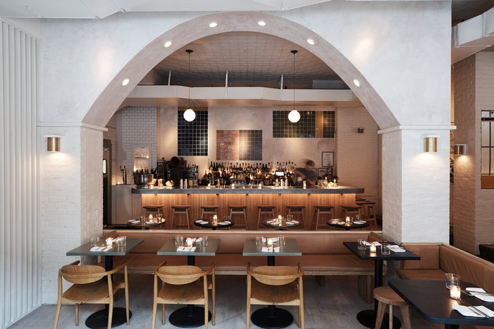 Shot of De Maria bar with the arch separating bar from dining room.