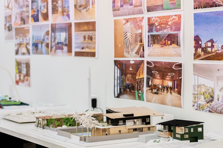 architectural models of modern homes on white desk