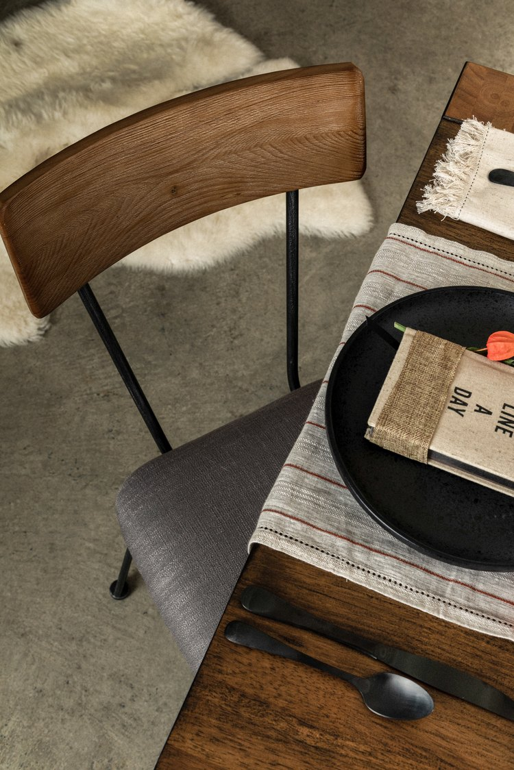 Rustic chic table and chair on concrete floor