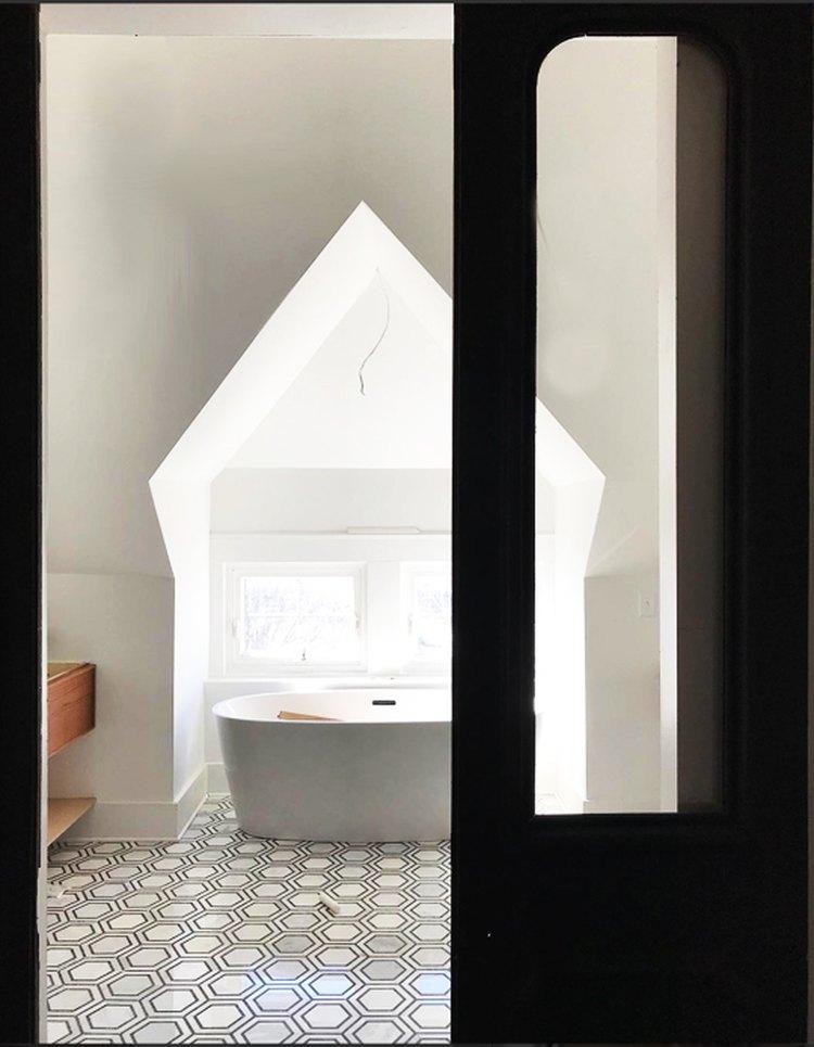 Good Bones: Restored Vintage Doors Lend Drama to a Majestic Master Bath