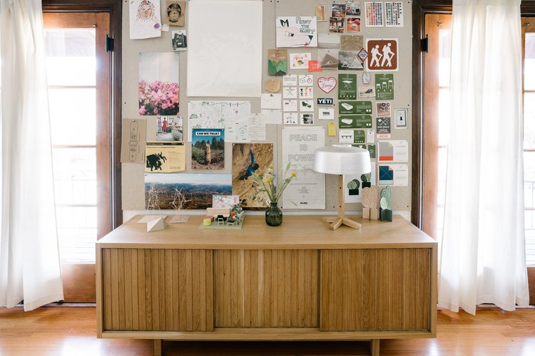 The Lodge Credenza and inspiration board in the Scout Regalia office