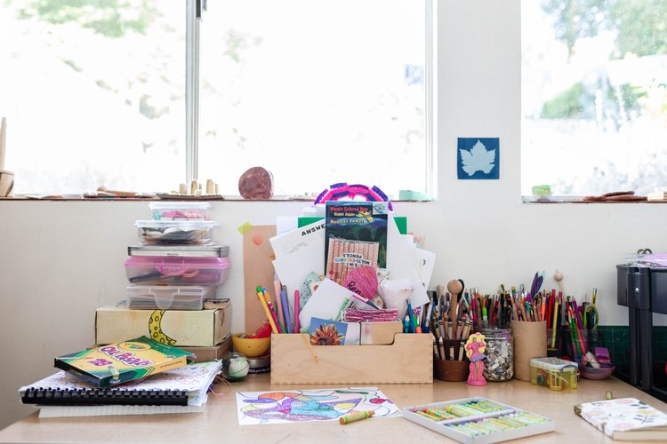 Children's desk in bedroom with art supplies