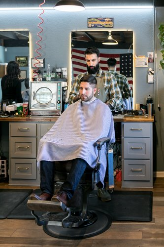 Tending to a client at the Rosewood Barbershop