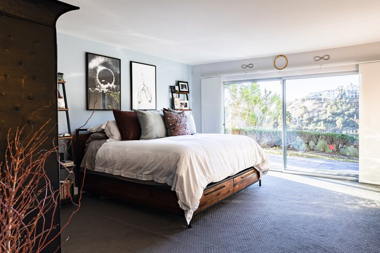 Carpeted master bedroom with canyon views