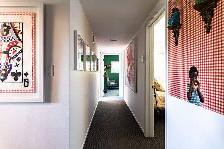 Hallway of artwork, including Genevieve Gaignard's mixed-media Mercy, Mercy Me (2019)