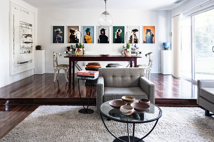 Raised dining area with wood table and artwork on walls