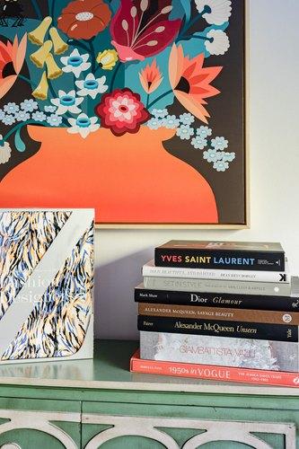 Fashion coffee table books atop art deco cabinet
