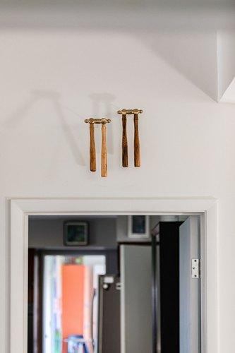 Doorway with wood artwork hanging above